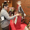 Wednesday was the first day to view the Sun Santa baskets at Lowell General Hospital. Megan King a delivery consultant at the hospital puts a ticket in for one of the baskets at the event. SUN/JOHN LOVE