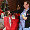 Wednesday was the first day to view the Sun Santa baskets at Lowell General Hospital. Hospital Nurse Kimberly Richard puts a ticket in to try and win one of the baskets. SUN/JOHN LOVE