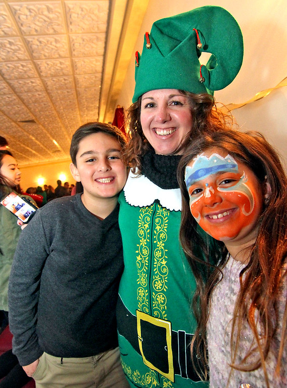 . In line for Mr & Mrs Santa Claus is William Gabriel 9, his mom, Jamie Gabriel (Enterprise Bank/ Human Resorce Dept) and her daughter Olivia Gabriel 7, all from Salem,NH, at the Enterprise Bank holiday celebration. SUN/ David H. Brow
