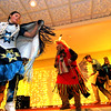 Preforming Native American Dance are members of the Greater Lowell Indian Cultural Association, at Enterprise Bank's 3nd Annual International Hoiliday Celebration. SUN/ David H. Brow