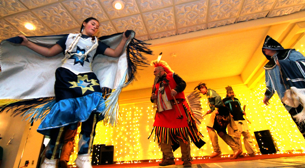 . Preforming Native American Dance are members of the Greater Lowell Indian Cultural Association, at Enterprise Bank\'s 3nd Annual International Hoiliday Celebration. SUN/ David H. Brow