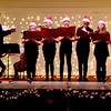Preforming Christmas songs at the Enterprise Bank's 3nd Annual International Holiday Celebration, is The Treble Chorus of New England. SUN/ David H. Brow