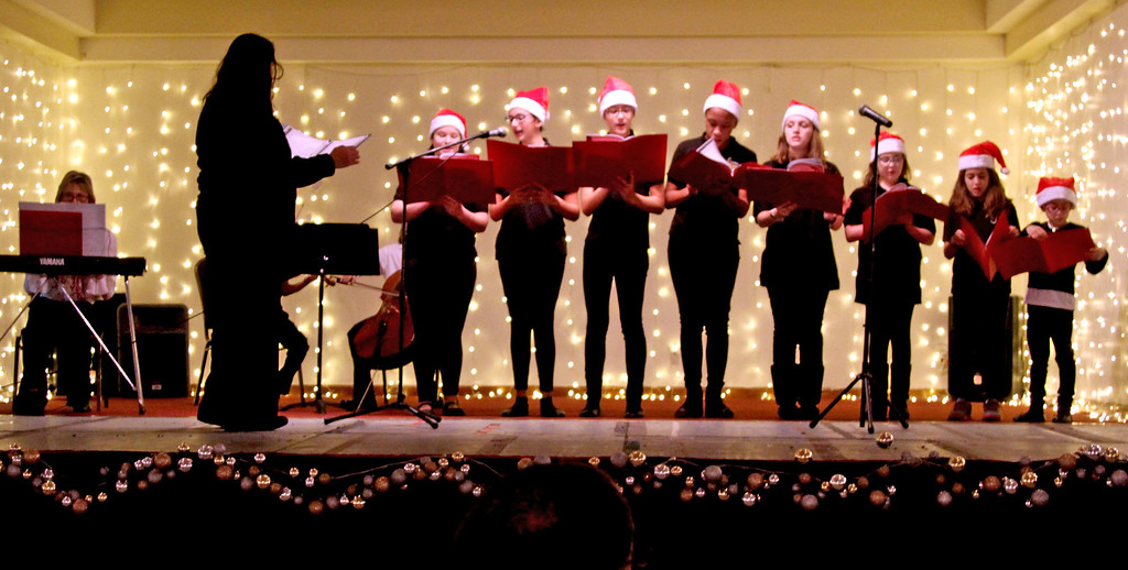 . Preforming Christmas songs at the Enterprise Bank\'s 3nd Annual International Holiday Celebration, is The Treble Chorus of New England. SUN/ David H. Brow
