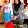 Showing her prize she just got from the SunSanta raffle table is Ellie Petro-Roy, 5, with Jackie Silva who was working the table at Enterprise Bank's 3nd Annual International Holiday Celebration. SUN/ David H. Brow