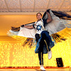 """Preforming a Native American Dance is Macayla """"Spirit Dancer"""" Libby of Lowell, she is a member of the Greater Lowell Indian Cultural Association, part of the program at the 3nd Annual International Holiday Celebration of Enterprise Bank. SUN/ David H. Brow"""