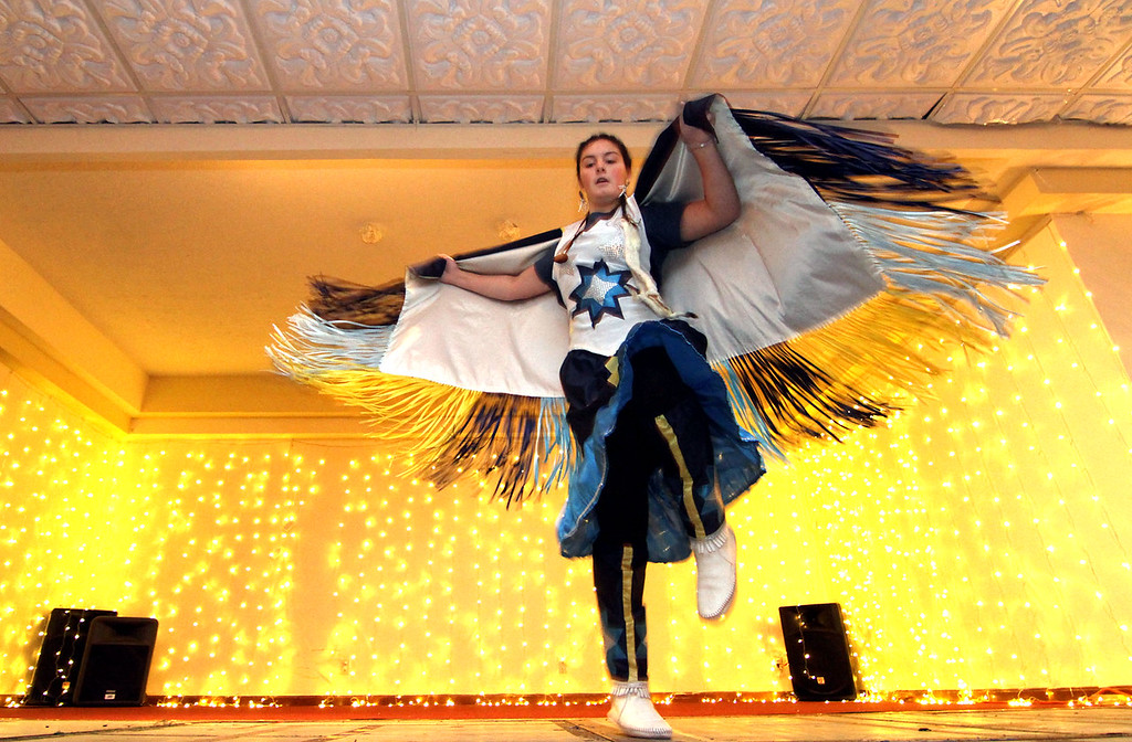 """. Preforming a Native American Dance is Macayla \""""Spirit Dancer\"""" Libby of Lowell, she is a member of the Greater Lowell Indian Cultural Association, part of the program at the 3nd Annual International Holiday Celebration of Enterprise Bank. SUN/ David H. Brow"""