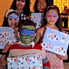 Holding their gifts just received from Ms&Mrs Santa Claus at the 3nd Annual Enterprise Bank's International Holiday Celebration is L-R, front to back, Antonio Cortes,4, Jalexa Cortes, 8, Charleni Zabala,12, Nicauri Zabala,9 and Jelexa Cortes, 9, all from Lowell. SUN/ David H. Brow