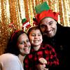 Having a holiday family photo taken at the Enterprise Bank's 3nd Annual International Holiday Celebration is Nancy Moniz, Austin Moniz 4, and Michael Moniz (Enterprise employee), the family is from Methuen. SUN/ David H. Brow