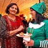 Enjoying good food and talk at Enterprise Bank's holiday celebration are Enterprise Bank employee's  L-R, Jasmine Pandit of NH, and Kruti Shah of Westford. SUN/ David H. Brow