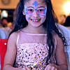 Here sporting a Winter Fariy face is Jelexa Cortes 9 of Lowell, as she takes in some food and in a front row seat at the Enterprise Bank's 3nd Annual International  Holiday Celebration in Lowell. SUN/ David H. Brow