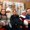 Here these kids give Mr & Mrs Santa Claus, (played by John Moynihan and Faith Walsh, both Enterprise Bank employee's), ideas for gifts are kids L-R, Payton Moro, 5, Darrian Moro,8, and William Moro,7 and from Methuen. SUN/ David H. Brow