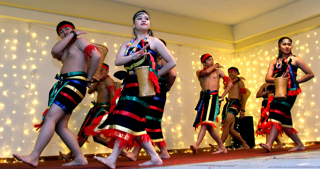 . Preforming Cambodian Dance are members of the Angkor Dance Troupe, at the 3nd Annual Enterprise Bank International Holiday Celebration in Lowell. SUN/ David H. Brow