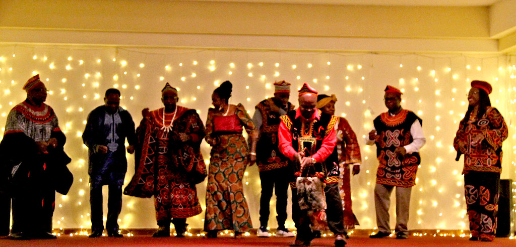 . Preforming Camaroonian Songs and Dance are members of the Cameroonians of Lowell Association, at the Enterprise Bank\'s 3nd Annual International Holiday Celebration. SUN/ David H. Brow