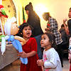 All smiles is Caroline Voeun,4, of Lowell, after receiving a doll balloon from balloon artist Robin Sullivan, Caroline's other family members next to her L-R, Paige Voeun,2, Presley Voeun,4, and Olivia Voeun,9, all at the Enterprise Bank's holiday celebration. SUN/ David H. Brow