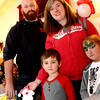 Taking in the crafts at the Lowell Sun Santa raffle table are L-R, Phil Bicknell his wife Tara Bicknell and children Brayden, 5 and Ryleigh, 7, all from Chelmsford, and at the Enterprise Bank's holiday celebration. SUN/ David H. Brow