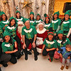 Enterprise Bank elfs with Mr & Mrs Santa Claus at the bank's 3nd Annual International Holiday Celebration in Lowell. SUN/ David H. Brow