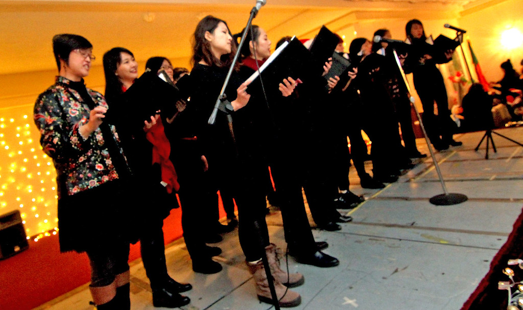 . The Cambridge Chinese Choral Society preforms Chinese Songs at the Enterprise Bank\'s 3nd Annual International Holiday Celebration. SUN/ David H. Brow
