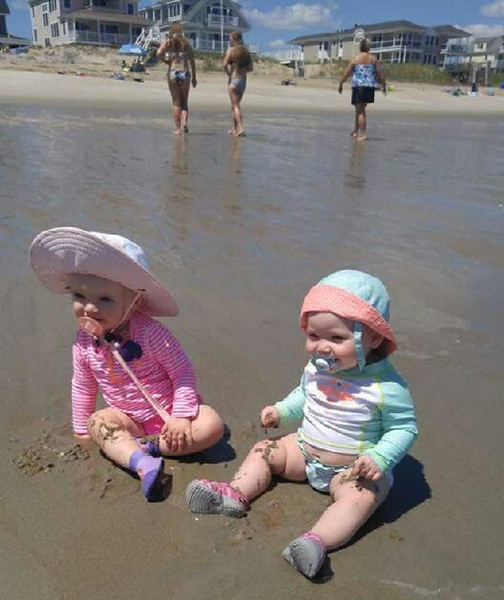 Danielle Hickey sent in this photo of these two beach babies enjoying their first time at the (Salisbury) beach. The one on the left in the big white hat is my is her god child Olivia Mcguane and she is 11 months old, and the one on the right with her adorable little belly hanging out is her daughter Emily and she is 8 months old.