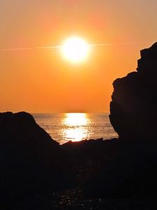 Sunset through the rocks from Hurst Castle, UK.