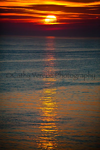 The sun glows red asit sets. Taken from Brighton Pier, UK