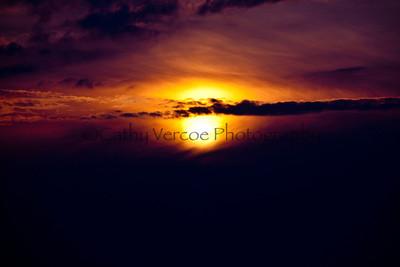 The sun sets through dense cloud. Taken from Needles Park, IOW, UK