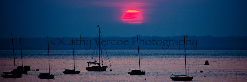 Sunset over boats moored at Yarmouth on the Isle of Wight 2012