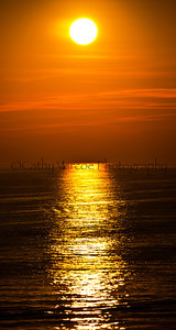 The sun sets on a beautiful still Summer evening. Taken from Brighton Pier, UK