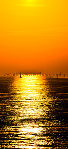 A solitary yacht silhouetted against the sunset. Taken from Brighton Pier, UK