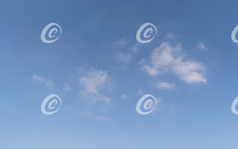 Small Ordinary Fluffy Clouds in a Clear Blue Summer Sky