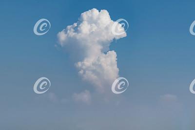 Thunderhead Cloud Rising up from a Haze