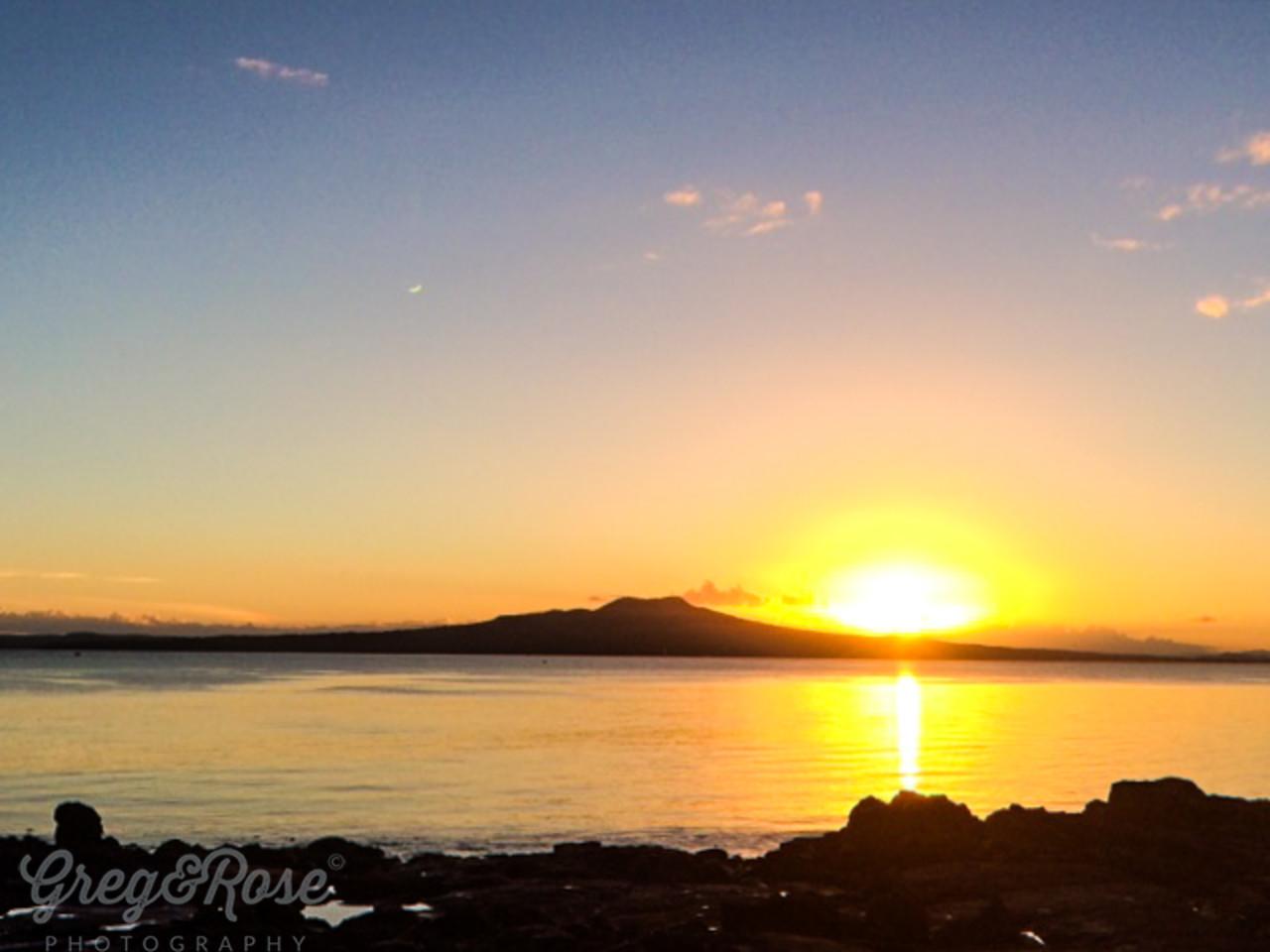 Early morning late  summer sunrise over Rangitoto