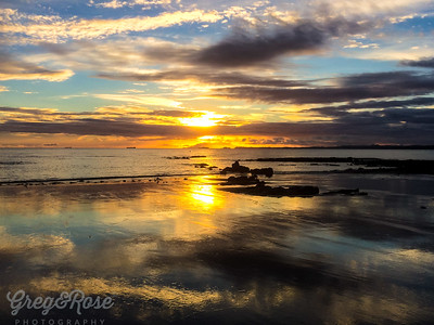 Morning Sunrise and Reflection on the wet  sand