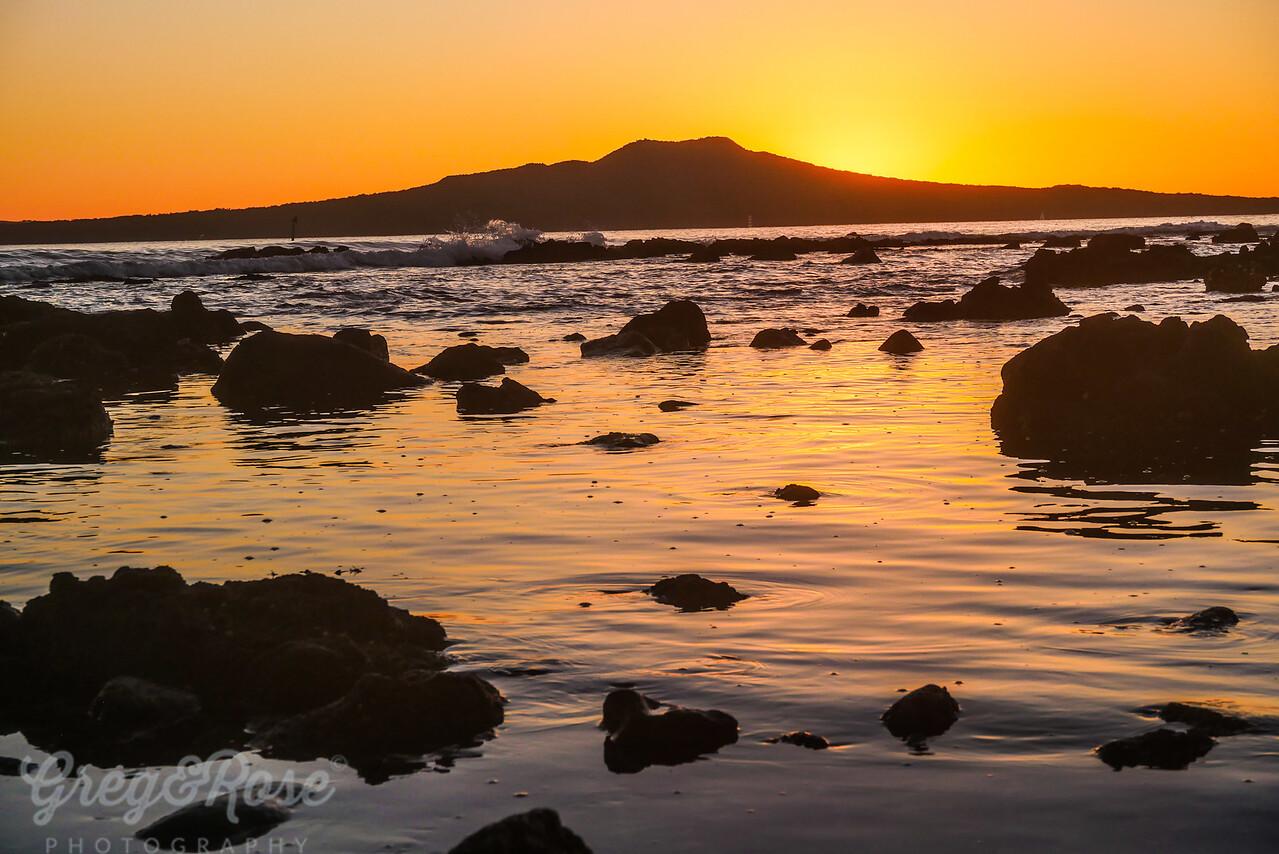 Sunrise reflection and rocks