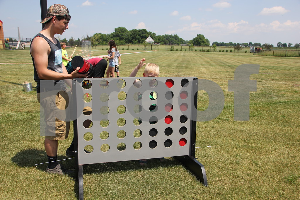 On Sunday, June 12, 2016, Fort Frenzy in Fort Dodge, held the 2nd Annual Hero's Picnic Fundraiser for Forces to raise money for Veteran's assistance programs. Seen left to right playing the game Connect Four is: Colton Austin, and (little boy) Murphy McCarville.