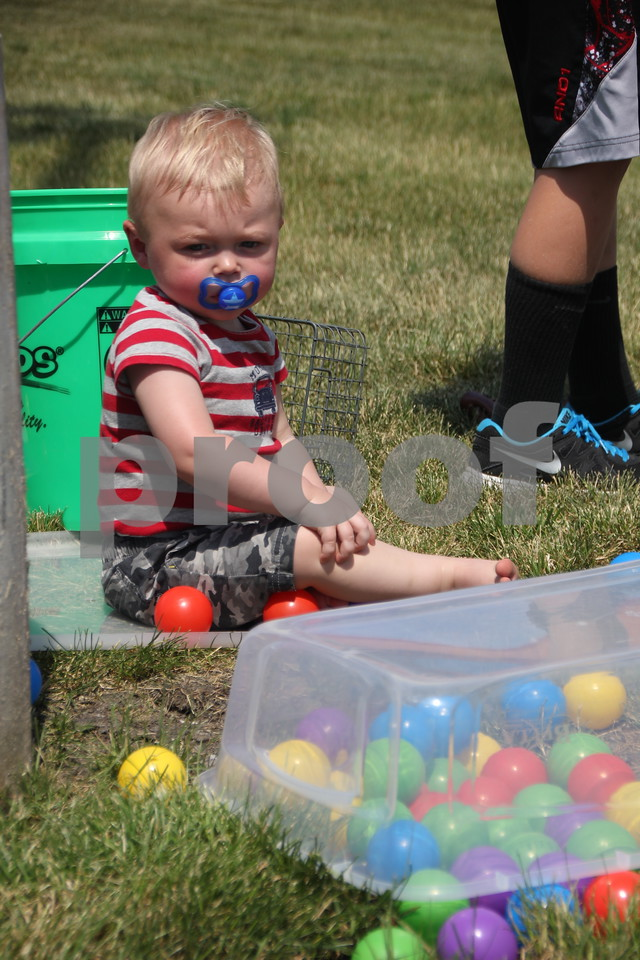 On Sunday, June 12, 2016, Fort Frenzy in Fort Dodge, held the 2nd Annual Hero's Picnic Fundraiser for Forces to raise money for Veteran's assistance programs. Seen playing with some of the balls from the game Kerplunk is Gus McCarville.