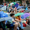 Rain on Sunday doesnt stop people from coming out to enjoy the last day of the Lowell Folk Festival. SUN/Caley McGuane