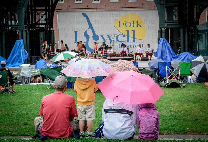 A little rain doesnt stop families from coming out to enjoy the Lowell Folk Festival on Sunday. SUN/Caley McGuane