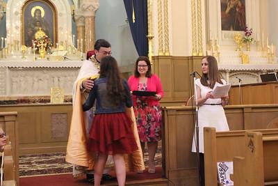 Graduates receiving their diplomas from Fr. Vasken