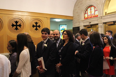 Graduates and their parents lining up in the vestibule for the Processional into the Church sanctuary