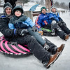 From left, Kurt Daniels and his son, Hunter, 4, of Pepperell and Ben Murphy and his son, Nicholas, 6, of Pepperell get ready to sled down Roby Park in Nashua on Sunday afternoon. SUN/Caley McGuane