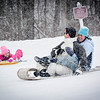 At right, Rob and Jeffa Lombardi of Nashua race their daughter Abby, 5, down the Roby Park hill on a snowy Sunday afternoon. SUN/Caley McGuane