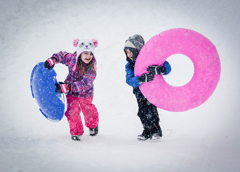 At left, Alaina Stamos, 5, of Nashua and her cousin Jayce Ecklund, 5, of Nashua run back up the Roby Park hill in Nashua after sledding. SUN/Caley McGuane