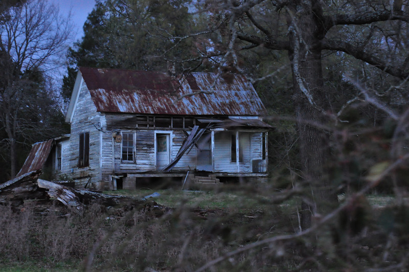 A spooky old house lit by moonlight. Imboden, AR