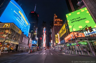 "NEW YORK, NEW YORK/USA – May 23, 2020: Times Square is largely empty of people during New York on ""Pause"" due to the COVID-19 coronavirus pandemic."