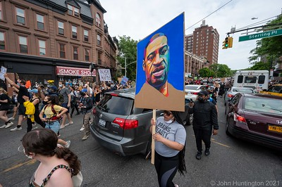 BROOKLYN, NEW YORK/USA – June 5, 2020: Black Lives Matter protesters assemble at Grand Army Plaza in Brooklyn and march down Flatbush Avenue in Brooklyn, NYC.