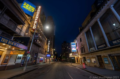 "NEW YORK, NEW YORK/USA – May 23, 2020: Closed Broadway theaters in the Times Square area are surrounded by empty streets during New York on ""Pause"" due to the COVID-19 coronavirus pandemic."