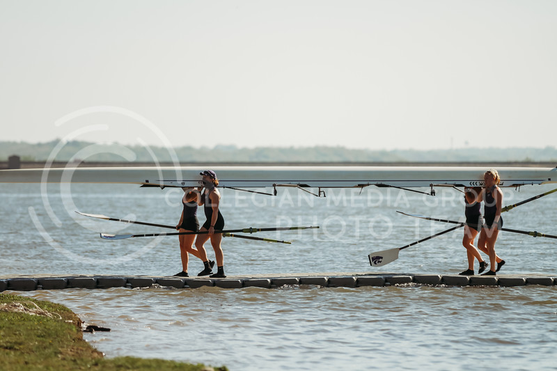 The 1v4 boat carries a boat in during the Sunflower Showdown against Kansas on May 1, 2021 at Wyandotte County Lake. (Sophie Osborn | Collegian Media Group)