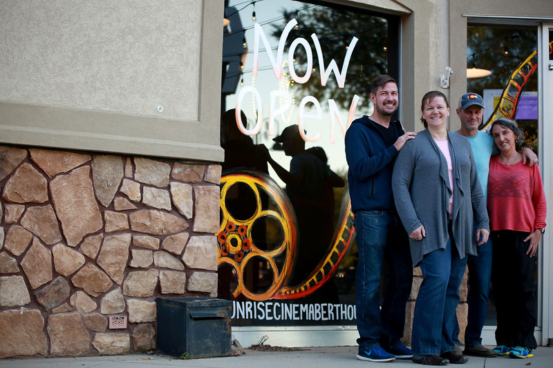 Theater managers Cheryl and Chris Kouns stand next to Wynne Maggi and Steve Byers, the owners of newly opened Sunrise Cinema in Berthoud on Oct. 12, 2018.<br /> Photo by Taelyn Livingston/ Loveland Reporter-Herald