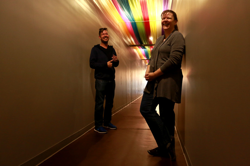 """Theater managers Chris and Cheryl Kouns stand under the """"hallway of happiness"""" at recently opened Sunrise Cinema on Oct 12, 2018 in Berthoud.<br /> Photo by Taelyn Livingston/ Loveland Reporter-Herald"""