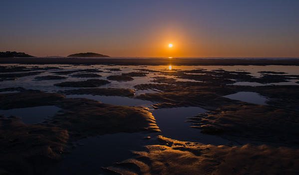 Sunrise over tidal pools on a Gloucester Morning